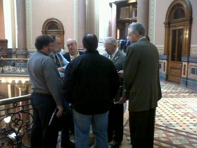 Representative Clel Baudler (D-Greenfield) talks with NRA members in statehouse rotunda after Senate passes gun-related legislation.